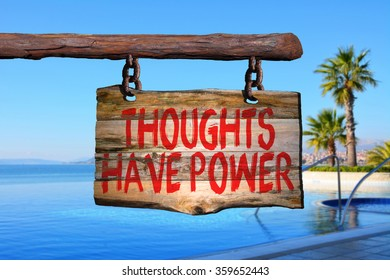 Thoughts have power motivational phrase sign on old wood with blurred background