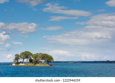 Thousan islands,Canada-august 4,2015:classic cottage on the banks of the St. Lawrence River in One thousen islands national park in Ontario during a summer day