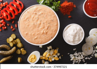 Thousand Island Dressing with ingredients close-up on the table. Horizontal view from above