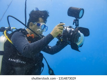 Thousand Island, Jakarta / Indonesia - November 24, 2017 : Underwater photography requires different equipment and skills compared to photos on land. need underwater casing and strong lights
