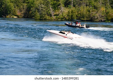 Thousand Islands Ontario, Canada. August 4, 2019.  People in boats   in the Saint  Lawrence River in summertime.
