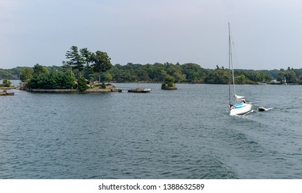 Thousand Islands in St  Lawrence River Ontario with sailboat