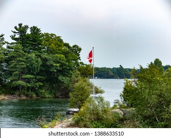 Thousand Islands in St  Lawrence River Ontario with Canadian Flag