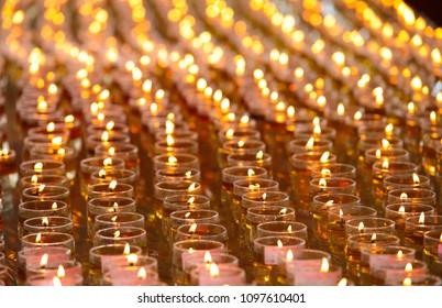 Thousand of oil lamps offering by devotees burning at Maha Vihara buddhish temple, Kuala Lumpur Malaysia, on wesak day.