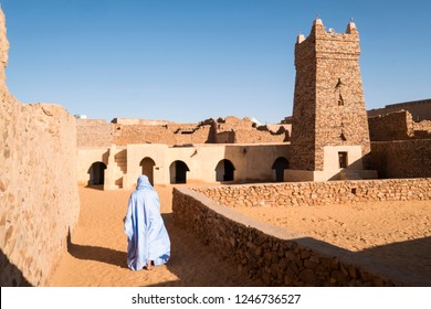 The thousand yars old town of Chinguetti with traditional wearing person