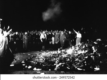 Thousands of books smolder in a Nazi bonfire, 1933. The burnings were conducted by the German Student Association of Nazi Germany.
