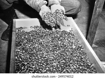 Thousands of gold wedding rings removed from victims of the Nazi German concentration camps. U.S. troops found jewelry and gold fillings, near Buchenwald concentration camp. May 5, 1945