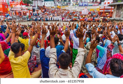 Thousands of Hindu Pilgrims/ People in the holy city of Haridwar in Uttarakhand, India during the evening light ceremony called Ganga arthi to worship river Ganga / Ganges. Culture, Tradition,ceremony