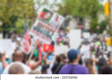 Thousands march in Staten Island. Blurred Background.