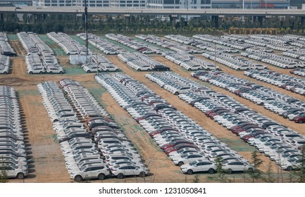 Thousands of new white chinese cars ready for delivery in ZhengZhouDong in China