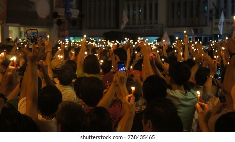thousands of people holding candle light