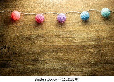 thread ball light bulbs.color light Christmas garland wood background