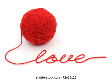 Thread ball with word 'love'  isolated on white background