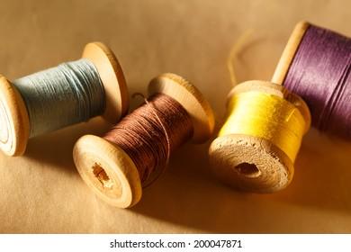 Thread bobbins on paper background