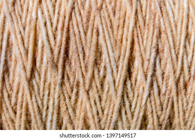 Thread in clew close up picture. Close up of light burlap texture background. Twine. Top view. Copy space.