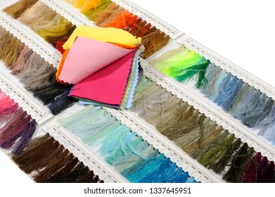 thread sample color card and fabric on white