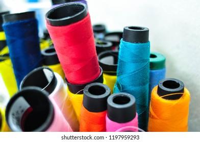 thread in spool. colorful cotton. nylon sewing. sapan. thread. sewing machine. Spun yarn. choice. colorful cotton. nylon sewing.