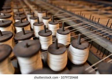 Thread Spools on a Vintage Loom