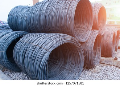 Threaded steel and rebar for construction are neatly arranged under cranes in the industrial steel market.construction background - Image.