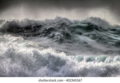 Threat of cataclysm Devastating hurricane. Killer wave it ocean storm weather with huge waves, Such waves cause catastrophic flooding on coast, destroy beach installation in situation climate change