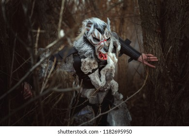 Threatening creature resembling a human wolf in the forest among the trees.