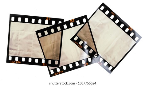 Three 35mm film strips or snips on white background with empty or blank frames, just blend in your content here