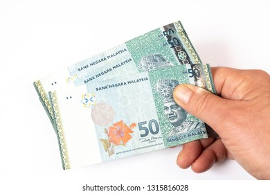three 50 Malaysian Ringgit banknotes in the hand