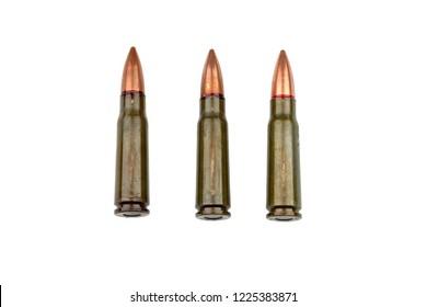 Three 7.62 mm cartridges for a Kalashnikov assault rifle isolated on white background