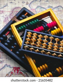 Three Abacus on an out of focus antique map