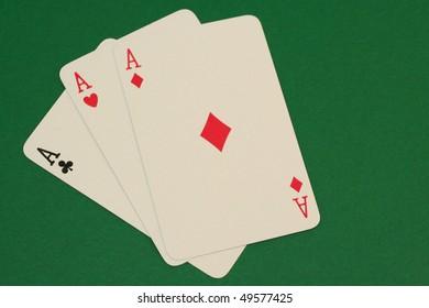 Three Aces on green background macro