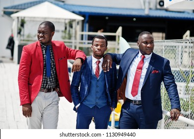Three african american happy succesfull mans at suit. Rich black business mans.