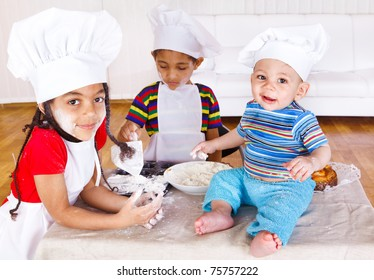 Three african american kids playing with flour