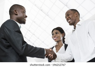 Three african business people handshake, Studio Shot, Cameroon