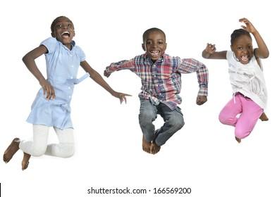 Three african kids jumping high, Studio Shot