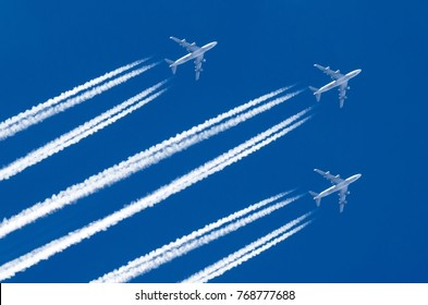 Three Airplane big four engines aviation airport contrail clouds