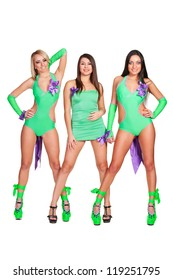 three alluring go-go dancers. isolated on white background