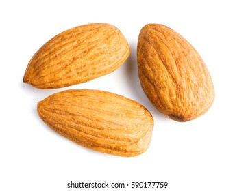 Three almonds nuts isolated on white background with clipping path. Top view. Macro.