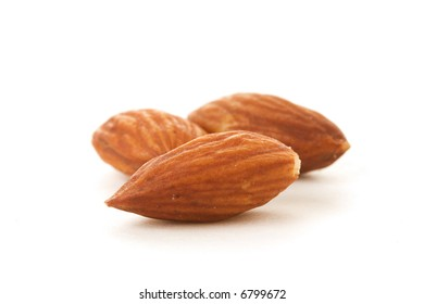 Three Almonds on a white background.