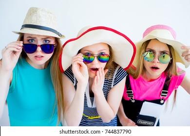 Three amazed girls with passports
