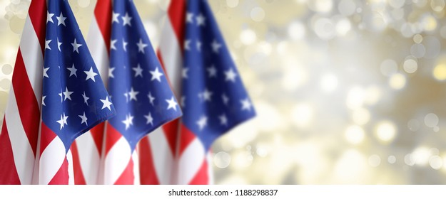 Three American flags in front of blurred background