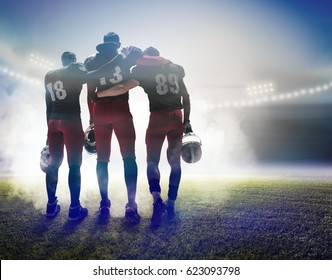 The three american football players on on stadium background. Super Bowl concept