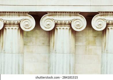 Three antique columns in doric style closeup