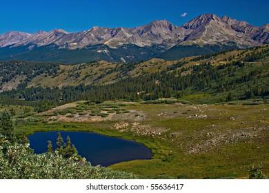 The Three Apostles above an alpine tarn near Buena Vista, Colorado