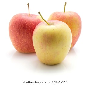 Three apples (Evelina variety) isolated on white background yellow red pale green