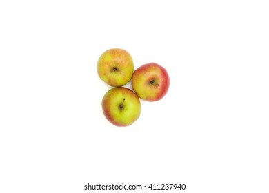 Three apples on a clear white background