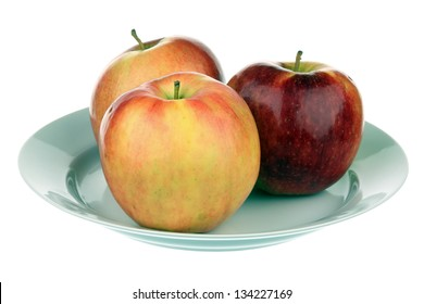 Three apples in a plate isolated over white background