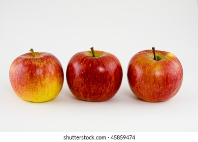 three apples in a row isolated on a white background