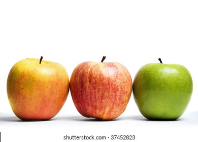 Three apples,red yellow and green, in a line