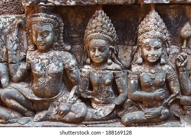 Three apsara statue on the wall of Angkor temple