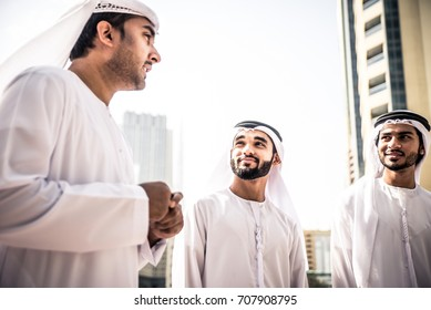 Three arabic business men spending time in Dubai